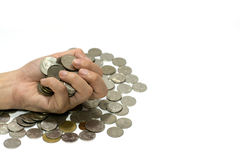 Hand clutching coins. stock photo