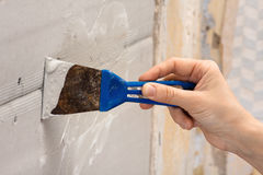 Hand coating wall of plaster with spatula Stock Photos