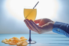 Hand with cocktail drink Royalty Free Stock Images