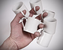 Hand and coffe cups Stock Images