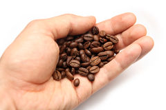 Hand with coffee beans Royalty Free Stock Images