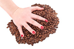 Hand with coffee beans Stock Photography