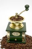 Hand coffee grinder. Coffee mill filled with beans, on a bean base Stock Images