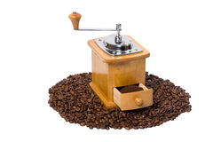 Hand coffee-grinder full of coffee Stock Photo