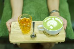 Hand and coffee and hot green tea Young people love to drink hot royalty free stock photos