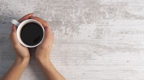 Hand coffee wooden background stock images