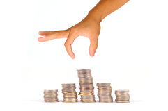 Hand with coin Royalty Free Stock Images