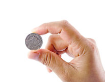 Hand and coin Stock Photo