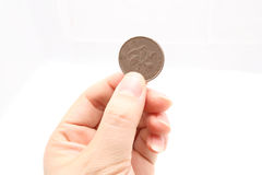 Hand with a coin. Man holding a coin Stock Photography
