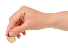 Hand with coin. Isolated on white background Royalty Free Stock Photo