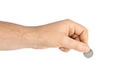 Hand with coin Stock Photos