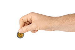 Hand with coin Royalty Free Stock Photo