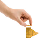 Hand with coin and money stairs Stock Image