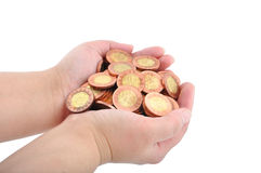 Hand and coins Stock Photography