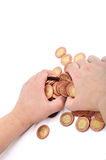 Hand and coins. Two hands grab shiny coins Stock Photos
