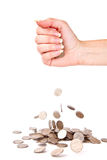 Hand and coins are failing down Stock Images