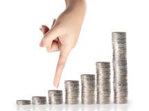 Hand coins in finger and row stacks them Royalty Free Stock Photos