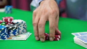 Hand collects red poker chips stock footage
