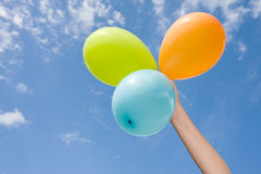 Hand with color balloons. Stock Images