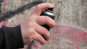 Hand with color spray can near the wall stock video footage