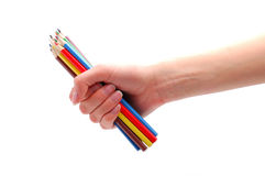 Hand with colored pencils. Over white Royalty Free Stock Photo
