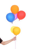 Hand with colorful balloons Royalty Free Stock Photos