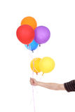 Hand with colorful balloons Stock Photos