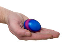 Hand with colorful Easter egg Royalty Free Stock Photography