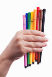 Hand with colorful pens Royalty Free Stock Photography