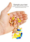 Hand with colorful pills Stock Photography