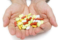 Hand with colorful pills Royalty Free Stock Images