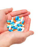 Hand with colorful pills on white Stock Photos
