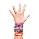 Hand with colorful rubber rainbow loom bracelets isolated Royalty Free Stock Photography
