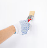Hand coloring wall with paintbrush Stock Photos