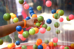 Hand with colourful ball. Hand of a child picking up colourful ball Stock Images