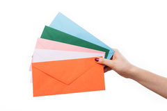 Hand with colourful envelopes Stock Photography