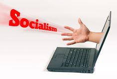 Socialism coming to get you. Hand coming out of computer pushing Socialism royalty free stock photography