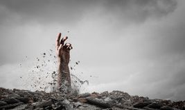 Buried alive but not broken royalty free stock image