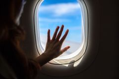 A Hand On A Commercial Airplane Window, Silhouette. Conceptual photo about the journey royalty free stock photos