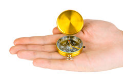 Hand and compass Royalty Free Stock Photography