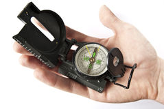 Hand with compass Stock Photography