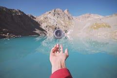Hand with Compass. Hand with Compass with mountains background stock photography