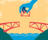 Hand complete the bridge with the last piece royalty free illustration