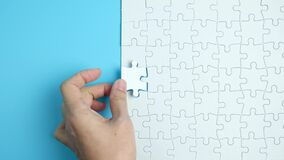 Hand complete the last piece white puzzle for business design