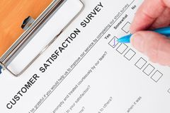 Hand Completing Customer Satisfaction Survey Royalty Free Stock Photos