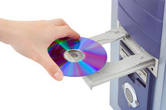 Hand and computer cd-rom. Isolated on white background Stock Photo