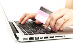Hand with computer and credit card Stock Image