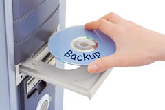 Hand and computer disk backup Stock Photos
