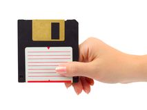 Hand with computer floppy disk Stock Photos