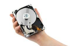 Hand and computer hard drive Stock Photos